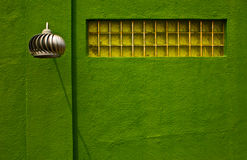 Art Deco Wall. Metal lamp, glass block window and a green wall in the art deco style.  Shot in Rockport, Texas Stock Images