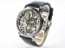 Art Deco Watch - Skeleton Movement. Art deco style wristwatch. The transparent case shows a skeleton movement on a white background Stock Images