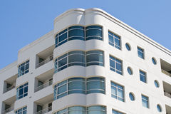 Art Deco Windows. Art deco style curved windows on a modern apartment building set against a blue sky Stock Photography