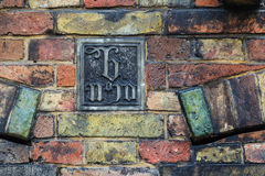 Art decor plate on old brickwork wall in Brugge, Belgium Royalty Free Stock Photography