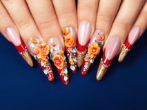 Art design  nails on blue background. Royalty Free Stock Images