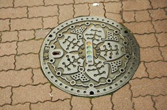 Art design symbol of Ameyayokocho market on Manhole cover at foo Stock Photo