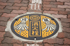 Art design symbol of Saitama city on Manhole cover at footpath b Royalty Free Stock Images
