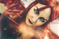 Art devil. Demoness close portrait. Stock Image