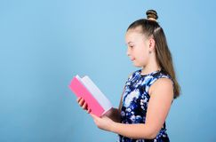 Art director. workbooks for writing. school diaries for making notes. small girl with pink note book. school child with. Notepad. smart trendy kid read note royalty free stock photo