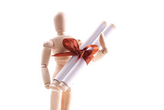 Art Doll Holding a Gift Scroll Royalty Free Stock Image