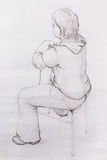 Art drawing beautiful girl sitting on a chair and white background. Royalty Free Stock Photography