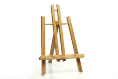 Art easel. Wooden art easel on bright background royalty free stock image
