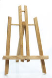 Art easel. Wooden art easel on bright background stock images
