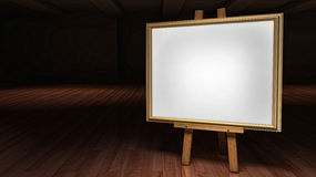 Art Easel with blank framed canvas in a darkened g Stock Images