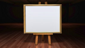 Art Easel with blank framed canvas in a darkened g Stock Image