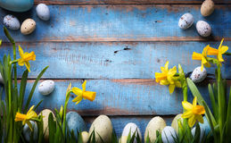 Art easter Background with easter eggs and spring flowers royalty free stock images