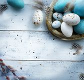 Easter background with Easter eggs on white table. Art Easter background with Easter eggs on white table Royalty Free Stock Images
