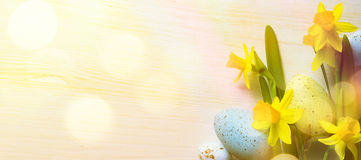 Art Easter Background with easter eggs and yellow spring flowers royalty free stock photos