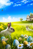 Art Easter bunny rabbit and easter eggs on meadow. Stock Photo