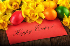 Art Easter Card background with spring flowers. Text Happy Easter Stock Images