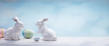 Art Easter eggs and Easter bunny on wooden background Royalty Free Stock Photos