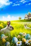 Art Easter-konijntjeskonijn en paaseieren op weide. Stock Foto