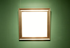 Art exhibition board. Empty white art exhibition board with golden frame royalty free stock photo