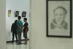 Art Exhibition of Social Criticism. Visitors observe student-made artwork Solo art exhibition is social criticism in Solo, Central Java, Indonesia. The artwork Royalty Free Stock Photos