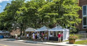 Art fair stands. In the Old Sainte-Rose, Laval, the gallery organizes exhibitions and art workshops throughout the year.  In the summer, weekends and bohemian Royalty Free Stock Photos