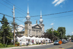 Art fair stands. In the Old Sainte-Rose, Laval, the gallery organizes exhibitions and art workshops throughout the year. In the summer, weekends and bohemian royalty free stock photo