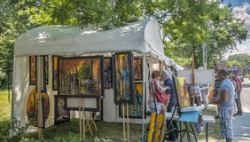 Art fair stands. In the Old Sainte-Rose, Laval, the gallery organizes exhibitions and art workshops throughout the year.  In the summer, weekends and bohemian Stock Photography