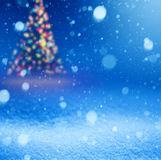 Art falling snow on the blue Christmas background Royalty Free Stock Photo