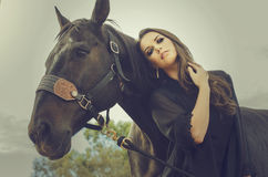 Art fashion Beautiful woman and horse Royalty Free Stock Photo