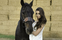 Art fashion Beautiful woman and horse Stock Image