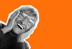 Art fashion collage: Happy surprised senior woman looking at camera. Happy surprised senior woman looking at camera  on orange background Royalty Free Stock Photo