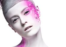 Art fashion girl with white skin and pink paint on. The face. Creative art beauty. Picture taken in the studio on a black background Royalty Free Stock Photo