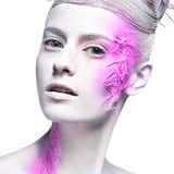 Art fashion girl with white skin and pink paint on stock image