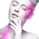 Art fashion girl with white skin and pink paint on stock photos