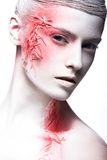 Art fashion girl with white skin and red paint on Royalty Free Stock Photography