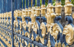 Art fence door. Texture of gold and blue color alloy fence door Royalty Free Stock Images