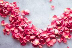 Rose petals on marble stone, floral background. Art of flowers, wedding invitation and nature beauty concept - Rose petals on marble stone, floral background stock photos