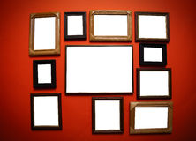 Art frames on red wall Royalty Free Stock Photos