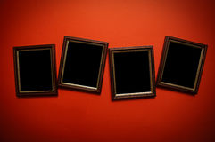 Art frames on red wall Stock Photo