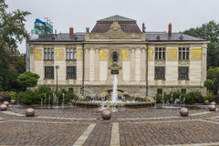 Art galleries building and fountain. A small square next to the main market square in Kraków. Building art galleries and fountain Stock Photo