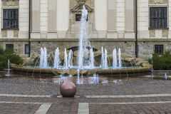 Art galleries building and fountain. A small square next to the main market square in Kraków.details of building art galleries and fountain Royalty Free Stock Photos