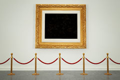 Art Gallery. Art museum gallery with blank painting frame hanging on the wall Stock Photography