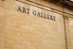 Art Gallery. A sign on the the side of a building that says art gallery Stock Photo