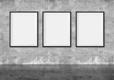 Art gallery. Blank picture frames on grunge wall background Royalty Free Stock Images