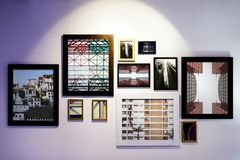 Art gallery frames hanged on wall Stock Image