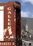 Art gallery sign and mural on Glasgow High Street, Scotland. Derelict gallery sign next to modern street art mural on high street in Glasgow, Scotland Royalty Free Stock Images