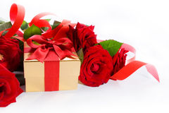 Art  gift box and red roses on white background Royalty Free Stock Images