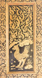 The art of Gilt Lacquer. The art of Guilt Lacquer or Lai Rod Nam, is a well-known from of decorative art. It appears on book cabinets that are used to hold Stock Image
