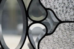 Art Glass. Detail of art glass with etching and wrought iron stock photo