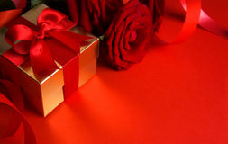 Art golden gift box on red background Royalty Free Stock Images